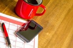 在日历的组织的月度活动 免版税库存照片