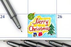 在日历笔的提示圣诞快乐 免版税库存图片