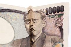 在日本票据的哀伤的面孔 免版税库存照片
