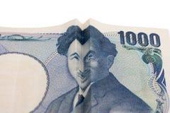 在日本票据的愉快的微笑的面孔 免版税图库摄影