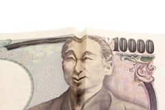 在日本票据的愉快的微笑的面孔 库存照片
