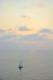 在日落下的风船 免版税库存照片