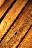 在日落光的老木纹理 免版税库存照片