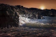 在日落威尔士的镯子海湾 免版税库存图片