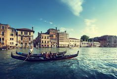在日落时间的两艘长平底船,威尼斯,意大利 图库摄影