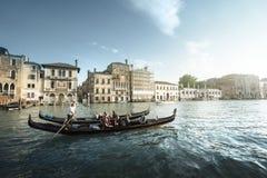 在日落时间的两艘长平底船,威尼斯,意大利 库存照片