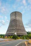 在日落时间的核电站风景 免版税库存照片