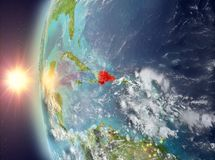 在日落期间的多米尼加共和国从空间 库存照片