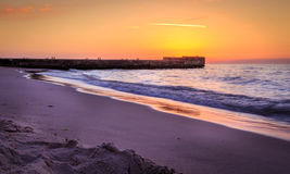 在日落期间的码头 免版税库存照片