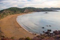 在日落期间的Playa de Cavalleria海滩 库存照片