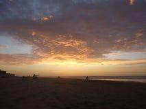 在日落海滩的云彩 图库摄影