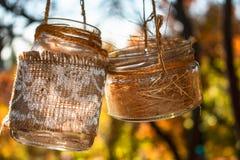 在日落的两个玻璃瓶子在天空中 免版税库存图片