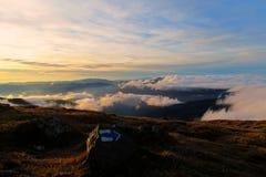 在日落的云彩上 库存照片