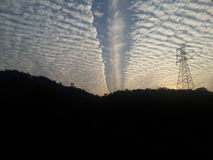 在日落的云彩 免版税库存照片