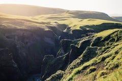 在日落的令人惊讶的史诗冰岛谷风景 库存图片