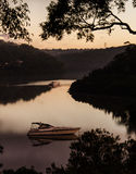 在日落的划船 库存照片