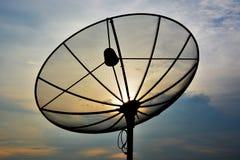 在日落的卫星 图库摄影