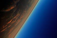 在日落的地球低轨道作为背景 免版税库存照片