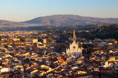 在日落的大教堂二三塔Croce 免版税库存照片