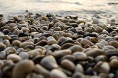 在日落的小卵石 库存图片