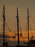 在日落的帆柱 免版税库存图片