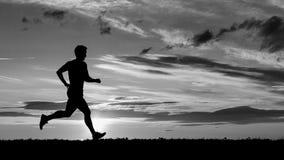 在日落的慢跑者 图库摄影