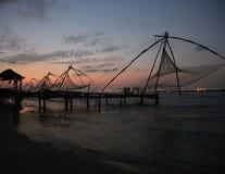 在日落的捕鱼网 免版税库存照片