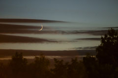 在日落的月亮 库存图片