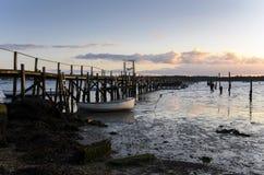 在日落的木跳船 免版税库存照片