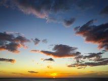 在日落的棉花糖云彩 图库摄影