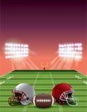 在日落的橄榄球领域 图库摄影