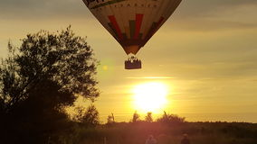 在日落的气球 免版税库存图片