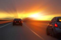 在日落的汽车 免版税库存图片