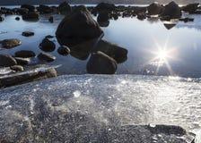 在日落的海滩冰 库存照片
