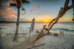 在日落的海滩吊床在土耳其人和凯科斯 图库摄影