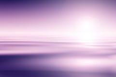 在日落的海洋 免版税图库摄影