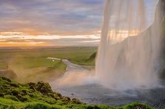 在日落的瀑布,冰岛 免版税库存图片