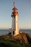 在日落的灯塔 免版税图库摄影