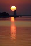在日落的灯塔 免版税库存图片