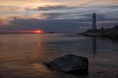 在日落的灯塔 库存照片