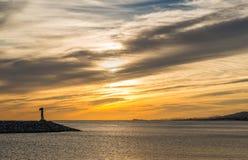 在日落的灯塔 库存图片