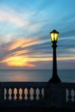 在日落的灯岗位 免版税库存照片