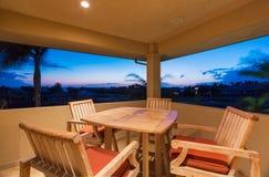 在日落的甲板和露台家具 免版税库存照片