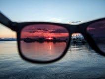 在日落的看法通过玻璃 免版税库存图片