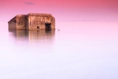 在日落的老凹下去的具体堡垒 库存照片