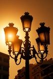 在日落的葡萄酒街灯 免版税库存照片