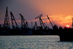 在日落的行业小船 库存照片