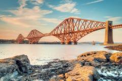 在日落的路轨桥梁 库存图片
