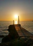 在日落的跳船 库存照片