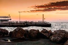 在日落的轮渡口岸 库存照片